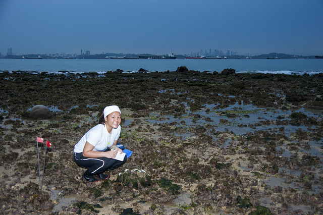 Mei Lin with Giant clam overlooking the city