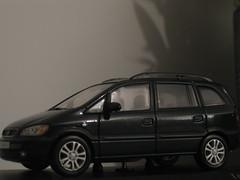 minivan(0.0), automobile(1.0), automotive exterior(1.0), opel(1.0), sport utility vehicle(1.0), vehicle(1.0), compact sport utility vehicle(1.0), land vehicle(1.0),
