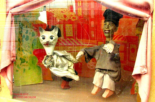 Creepy puppets in a Paris shop window...a cat and--Obama??!?