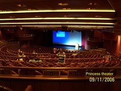movie theater, performing arts center, music venue, theatre, stage, theatre, auditorium, audience, convention center,