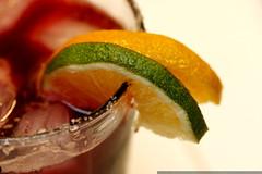 salt, lime and orange slices on the rim of a blackbe…