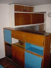 shelf(0.0), sideboard(0.0), bookcase(0.0), desk(0.0), shelving(1.0), furniture(1.0), room(1.0), cupboard(1.0), cabinetry(1.0),