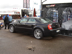 automobile(1.0), automotive exterior(1.0), wheel(1.0), vehicle(1.0), chrysler 300(1.0), chrysler(1.0), sedan(1.0), land vehicle(1.0), luxury vehicle(1.0),