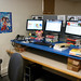 Oblique View Of Three-Headed Monster On Standing Desk