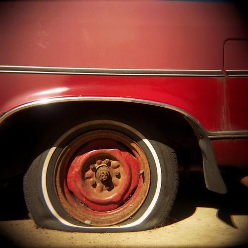 red car red rim black tire flat