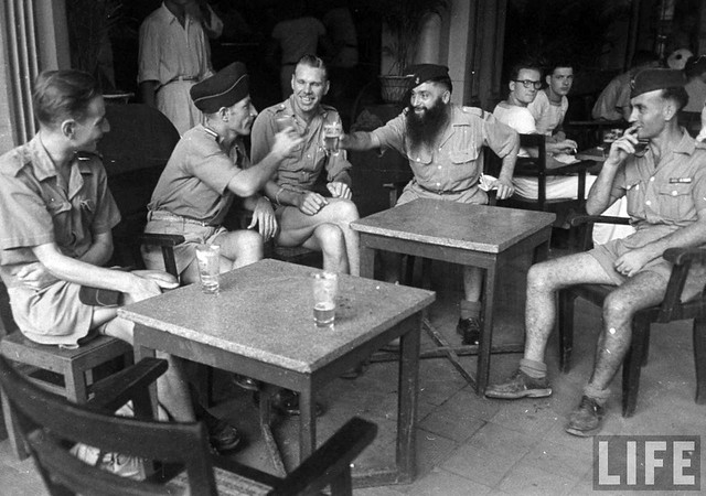 1948 - French soldiers sitting in sidewalk cafe, in French Indochina