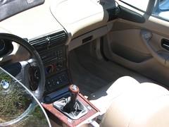 wheel(0.0), automobile(1.0), automotive exterior(1.0), bmw(1.0), vehicle(1.0), bmw z3(1.0), steering wheel(1.0), land vehicle(1.0), luxury vehicle(1.0),