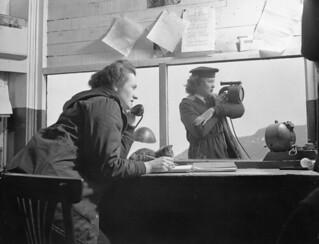 Signallers Marian Wingate and Margaret Little of the Women's Royal Canadian Naval Service at work. / Marian Wingate et Margaret Little, spécialistes des transmissions du Service féminin de la Marine royale du Canada, au travail à St. John's