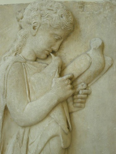 Marble grave stele of a little girl with doves Greek 450-440 BCE found on the island of Paros