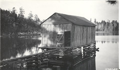 cottage(0.0), house(0.0), boathouse(1.0), hut(1.0), shack(1.0), monochrome photography(1.0), monochrome(1.0), black-and-white(1.0),