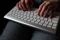 woman's fingers on a keyboard