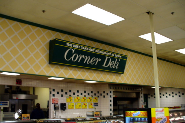 The corner deli department sign.