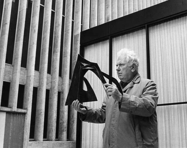 Alexander Calder with a scale model of his sculpture Le Guichet. Photo by Bob Serating, courtesy of Lincoln Center. All Rights Reserved.