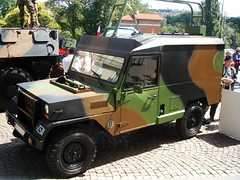 hummer h1(0.0), light commercial vehicle(0.0), jeep dj(0.0), armored car(1.0), automobile(1.0), automotive exterior(1.0), military vehicle(1.0), sport utility vehicle(1.0), vehicle(1.0), off-roading(1.0), off-road vehicle(1.0), bumper(1.0), land vehicle(1.0),