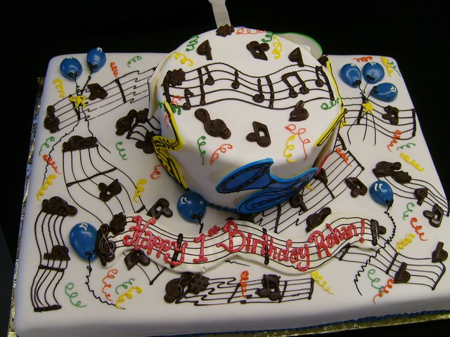 Cake Decorations Musical Instruments : A music-themed cake with chocolate music notes and cut-out ...