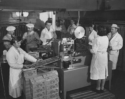 Packing Carsten's weiner sausages on an assembly line, Tacoma, Washington