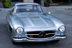 convertible(0.0), automobile(1.0), automotive exterior(1.0), vehicle(1.0), automotive design(1.0), mercedes-benz(1.0), mercedes-benz 190sl(1.0), mercedes-benz 300sl(1.0), compact car(1.0), antique car(1.0), land vehicle(1.0), sports car(1.0),