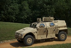 hummer h1(0.0), armored car(1.0), automobile(1.0), military vehicle(1.0), vehicle(1.0), off-roading(1.0), humvee(1.0), off-road vehicle(1.0), land vehicle(1.0), military(1.0),