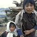 Woman and child. Woman carries wood.  Bhutan