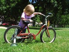 endurance sports(0.0), mountain bike(0.0), road bicycle(0.0), bicycle motocross(0.0), bmx bike(0.0), tricycle(0.0), recumbent bicycle(0.0), wheel(1.0), vehicle(1.0), training wheels(1.0), sports equipment(1.0), land vehicle(1.0), bicycle(1.0),