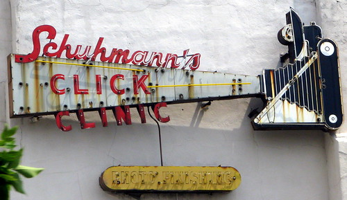 Schuhmann's Click Clinic old sign