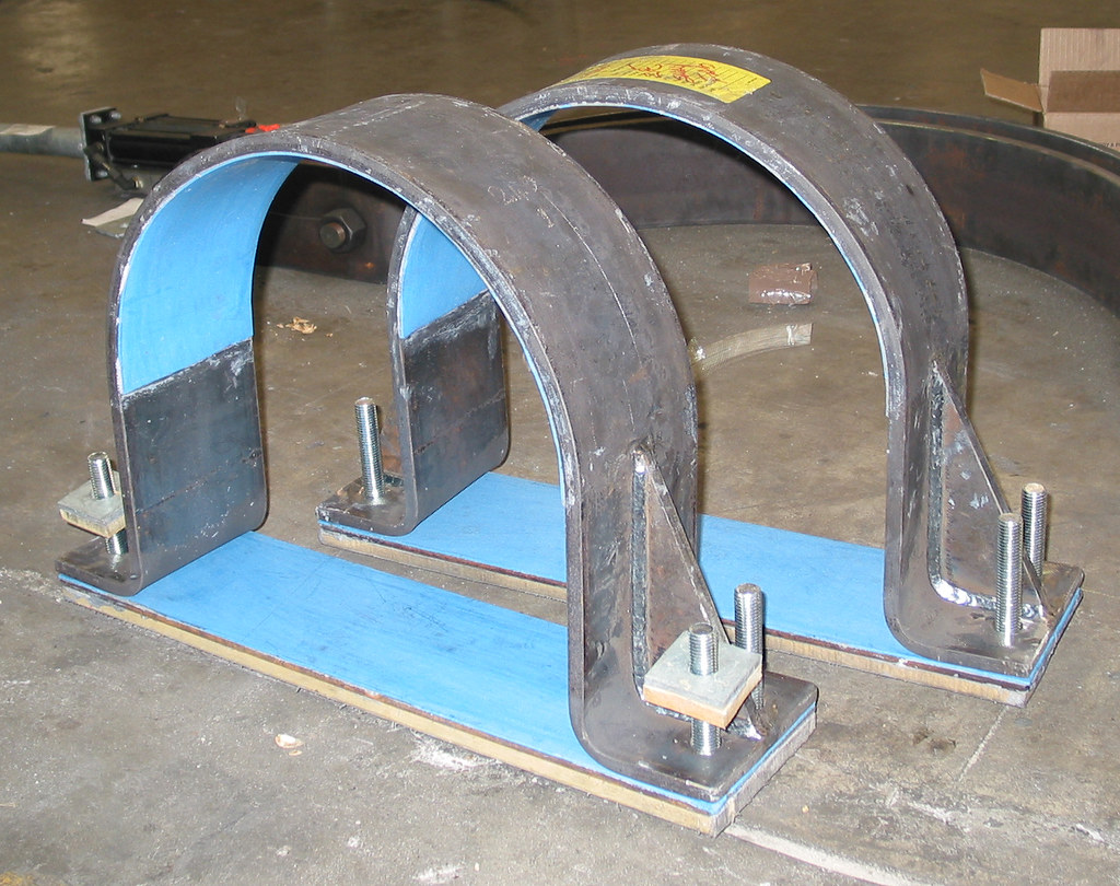 Laminated Steel Pipe ~ Two dia hd hold down clamps for an oil refinery