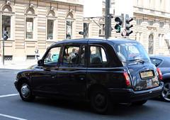 mini cooper(0.0), automobile(1.0), automotive exterior(1.0), wheel(1.0), vehicle(1.0), compact sport utility vehicle(1.0), mini(1.0), city car(1.0), compact car(1.0), tx4(1.0), sedan(1.0), land vehicle(1.0), luxury vehicle(1.0),