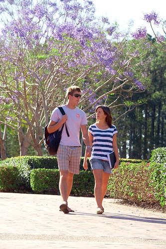 Two students walking at the entrance to Bond