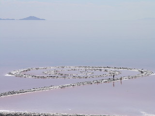 Two people walk along Spiral Jetty