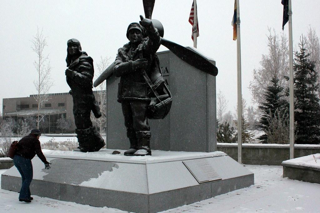 kate brushing off wwii memorial