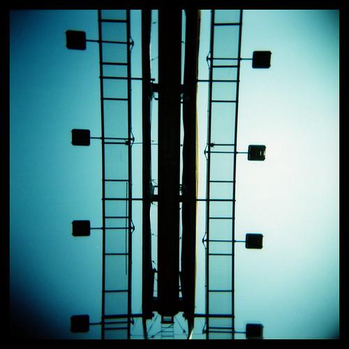 morning blue sky urban color 6x6 vertical metal sunrise lights xpro crossprocess toycamera perspective lofi billboard plastic squareformat expiredfilm detroitmichigan holga120n ©allrightsreserved 120mediumformat fujifilmrdpiii rckrawczykjr ralphkrawczykjr