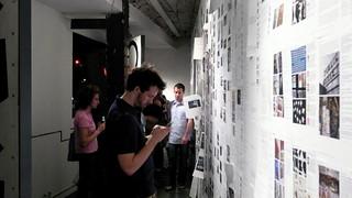 People reading blog posts at Postopolis! closing party