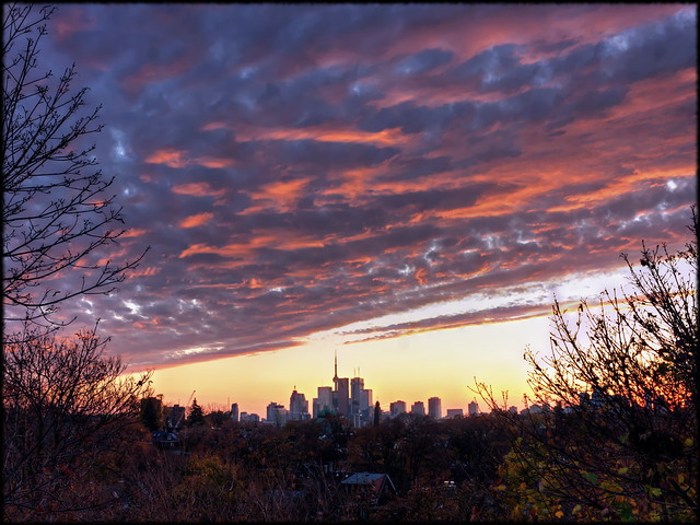Weather front over Toronto (clear skies push back clouds)