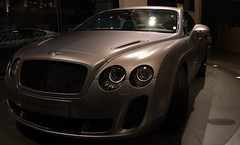bentley continental flying spur(0.0), city car(0.0), convertible(0.0), automobile(1.0), automotive exterior(1.0), bentley continental supersports(1.0), wheel(1.0), vehicle(1.0), performance car(1.0), automotive design(1.0), bentley continental gtc(1.0), bentley continental gt(1.0), bumper(1.0), land vehicle(1.0), luxury vehicle(1.0), bentley(1.0), supercar(1.0), sports car(1.0),