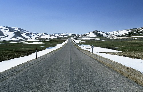 Cleared road through snow capped hills | by World Bank Photo Collection