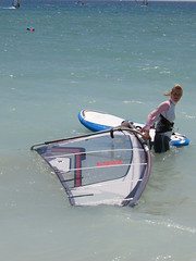 sailing(0.0), beach(0.0), dinghy(0.0), watercraft rowing(0.0), bay(0.0), boating(0.0), shore(0.0), coast(0.0), kitesurfing(0.0), boat(0.0), paddle(0.0), sail(1.0), surface water sports(1.0), boardsport(1.0), water(1.0), vehicle(1.0), sea(1.0), surfing(1.0), ocean(1.0), wave(1.0), vacation(1.0), water sport(1.0), windsurfing(1.0), surfboard(1.0),