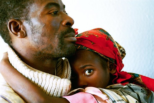 Man with sick children in local hospital.  Mozambique