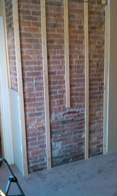Fireplace remodel - drywall over brick? | TexAgs