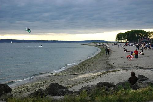 Kite surfing, gray overcast warm summer evening, Golden Gardens park, Seattle, Washington, USA by Wonderlane