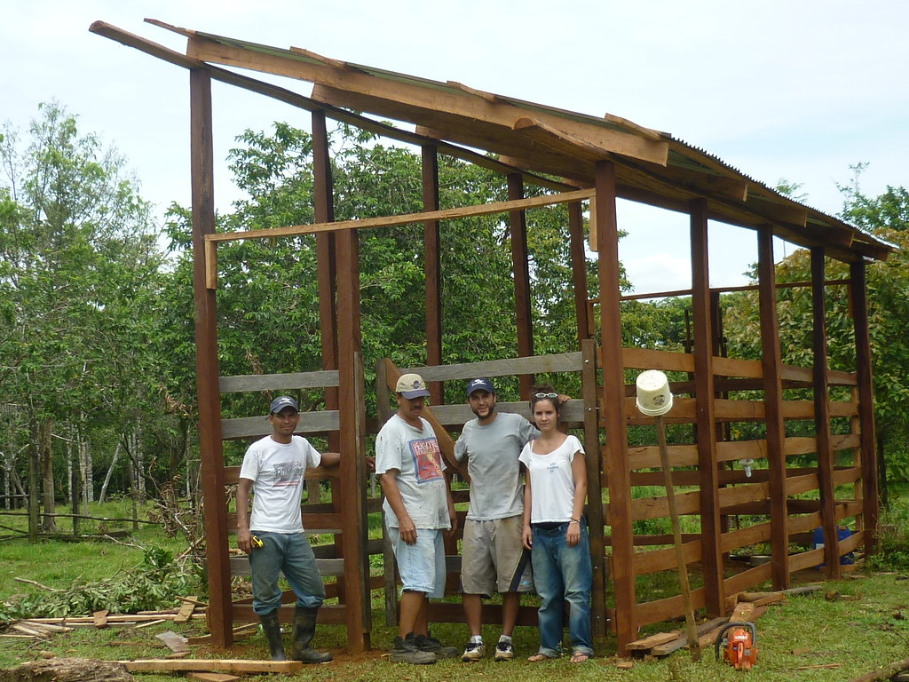 Panthera Field Technician Ever Urbina, livestock enclosure owner Rafael Monge, Panthera Field Scientist Daniel Corrales, and Josephine Dusapine posing in front of the finished enclosure.   Read 'Panthera's Guide to Building a Livestock Corral' from our October 2010 newsletter at www.panthera.org/november-2010-newsletter.  Learn more about the work Panthera's Costa Rica team is doing at pantheracostarica.org/.   Also read about our jaguar conservation work in other countries through our Jaguar Corridor Initiative - www.panthera.org/programs/jaguar/jaguar-corridor-initiative - and Pantanal Jaguar Project - www.panthera.org/programs/jaguar/pantanal-jaguar-project.    © Daniel Corrales/Panthera (automatic)