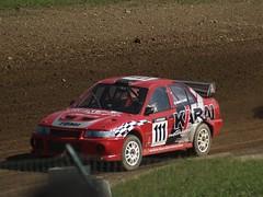 auto racing(0.0), touring car racing(0.0), family car(0.0), touring car(0.0), sedan(0.0), automobile(1.0), rallying(1.0), racing(1.0), vehicle(1.0), stock car racing(1.0), sports(1.0), dirt track racing(1.0), motorsport(1.0), rallycross(1.0), world rally car(1.0), compact car(1.0), race track(1.0), land vehicle(1.0), luxury vehicle(1.0), world rally championship(1.0), sports car(1.0),