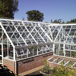 An L Shaped Free standing Hartley bespoke greenhouse
