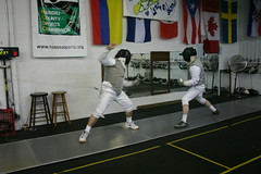 foil(0.0), weapon combat sports(1.0), fencing weapon(1.0), sport venue(1.0), individual sports(1.0), contact sport(1.0), sports(1.0), combat sport(1.0), competition event(1.0), fencing(1.0),