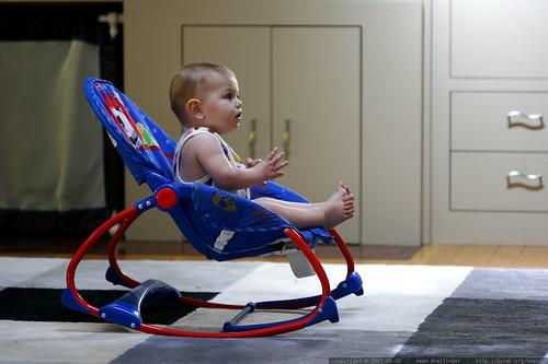 watching baby einstein videos in his rocking chair    MG 3895
