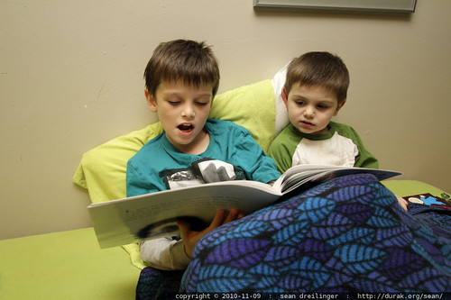 nick reading his little brother a story to cheer him up