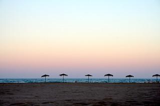 Bild av Platja de la Patacona. sunset sea beach water mar agua playa sombrillas alboraia alboraya patacona