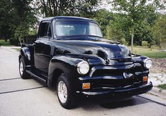 1941 ford(0.0), compact car(0.0), automobile(1.0), automotive exterior(1.0), pickup truck(1.0), vehicle(1.0), truck(1.0), mid-size car(1.0), chevrolet advance design(1.0), bumper(1.0), land vehicle(1.0), motor vehicle(1.0),
