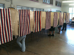 Voters inside booths at Kuhio Elementary.