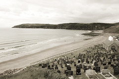 Clifftop churchyard in sepia