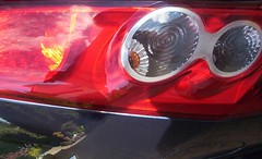 wheel(0.0), rim(0.0), headlamp(0.0), automotive tail & brake light(1.0), automotive exterior(1.0), vehicle(1.0), automotive lighting(1.0), light(1.0), bumper(1.0),